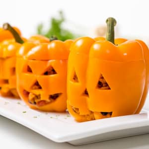 Jack-o'-lantern chicken and rice stuffed peppers