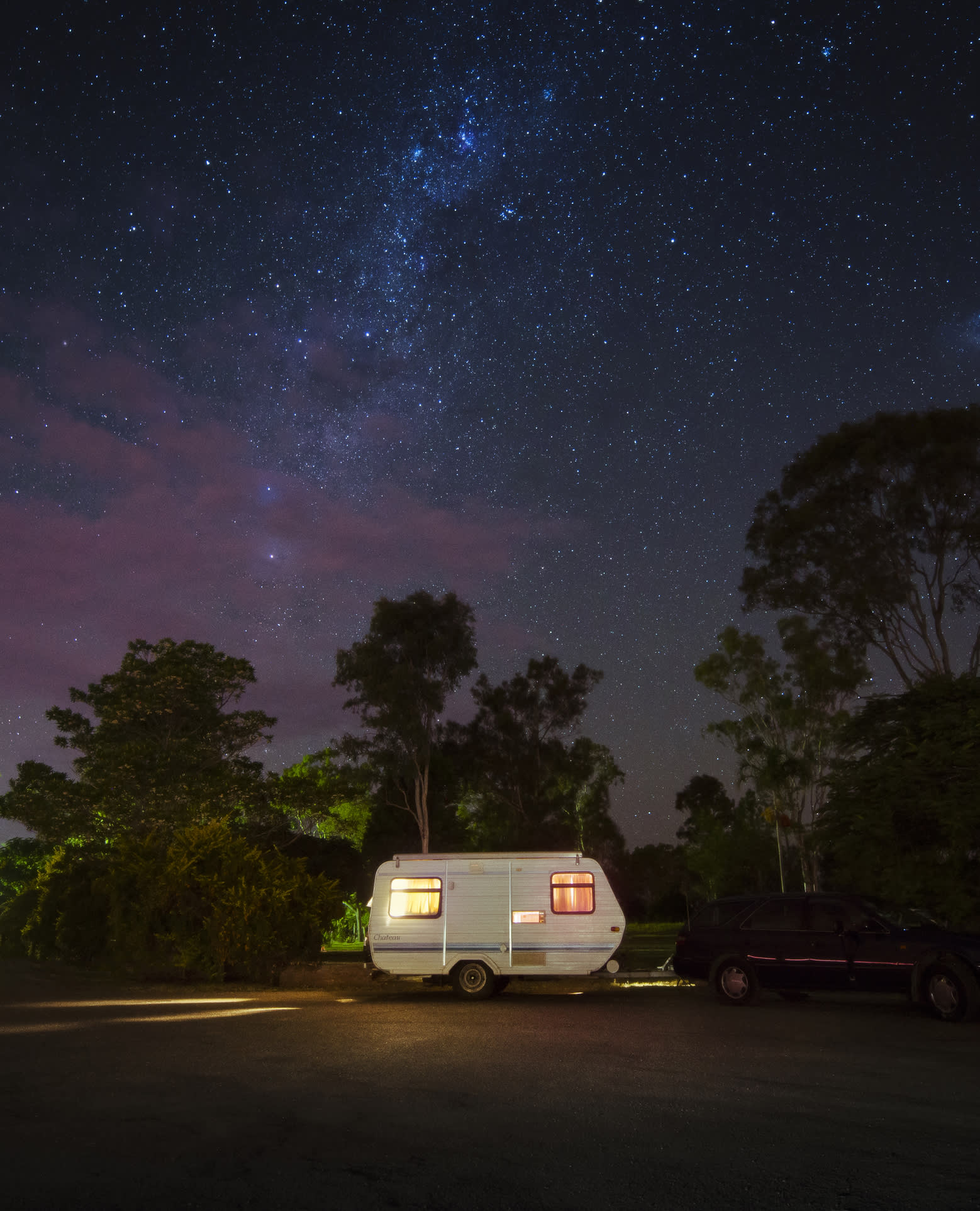 A parked caravan on a starry night