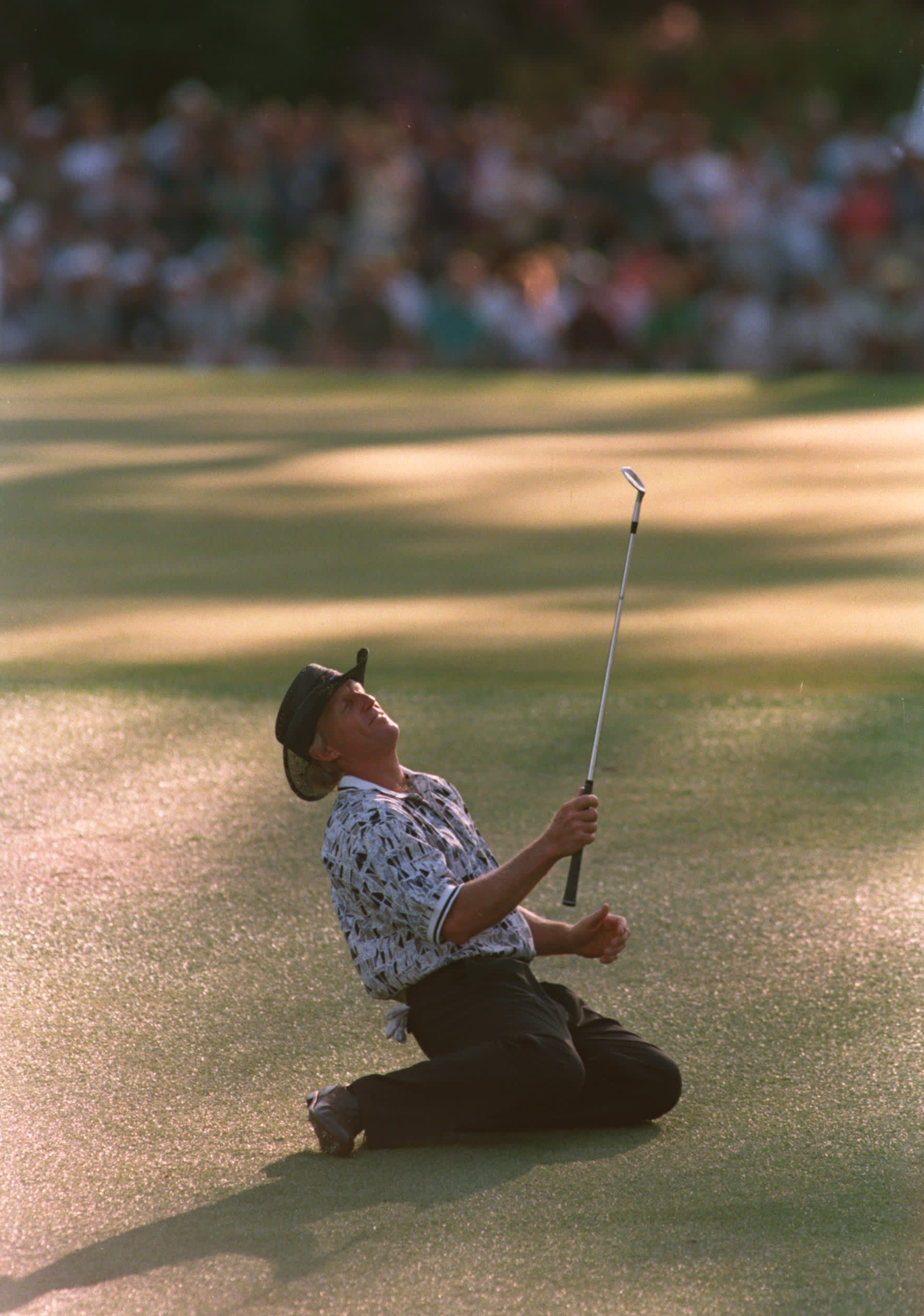 14 Apr 1996 :  Greg Norman of Australia collapses on the ground after narrowly missing his chip shot on the 15th green during the final tound of the 1996 US Masters Golf Championship at the Augusta National Golf Club in Augusta, Georgia. Nick Faldo wenton to win the event from Greg Norman. Mandatory Credit: Stephen Munday/ALLSPORT
