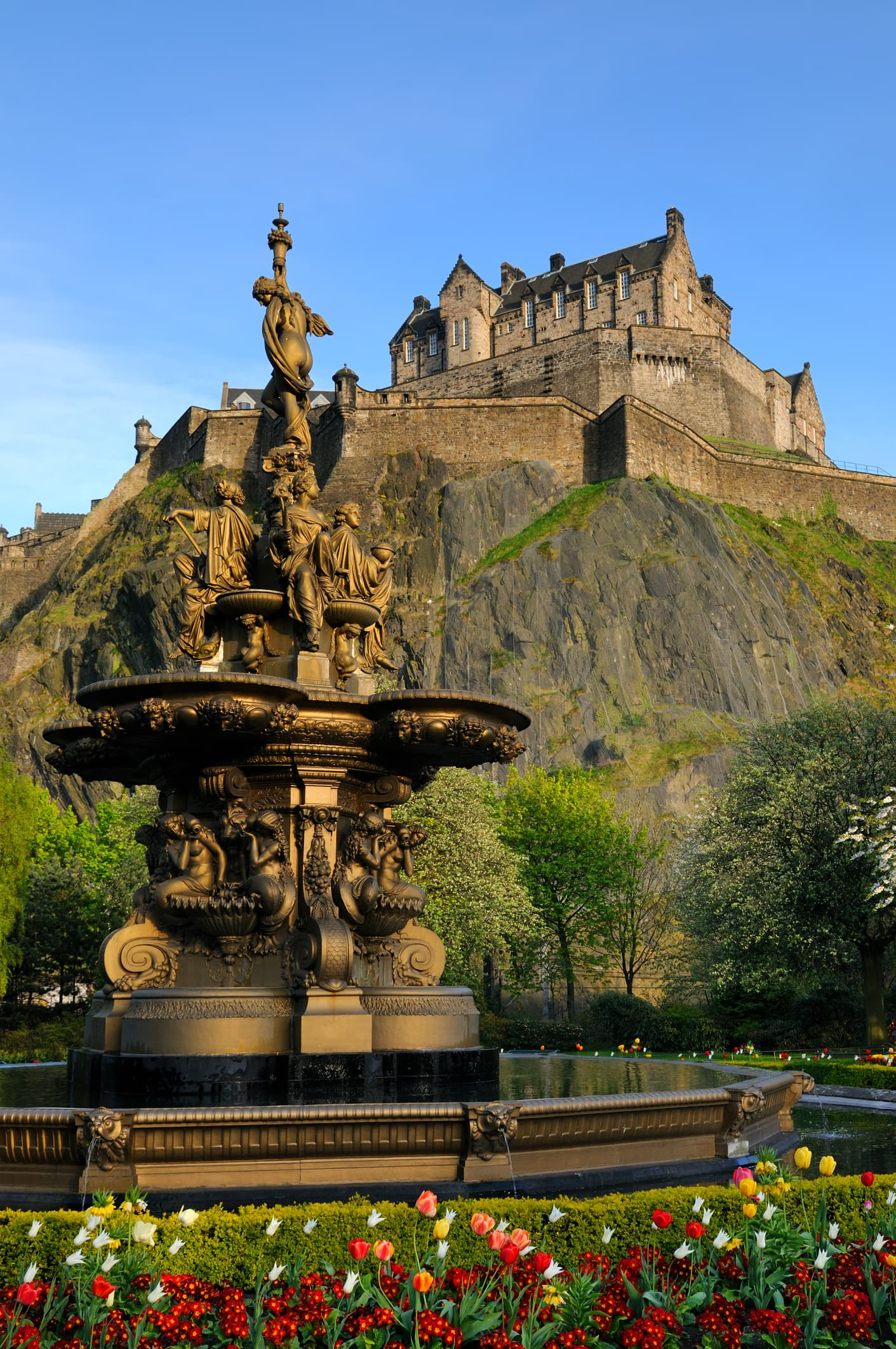A view of the iconic Edinburgh Castle, looking up from Princess Street gardens with the Ross fountain in the foreground. XL image size.