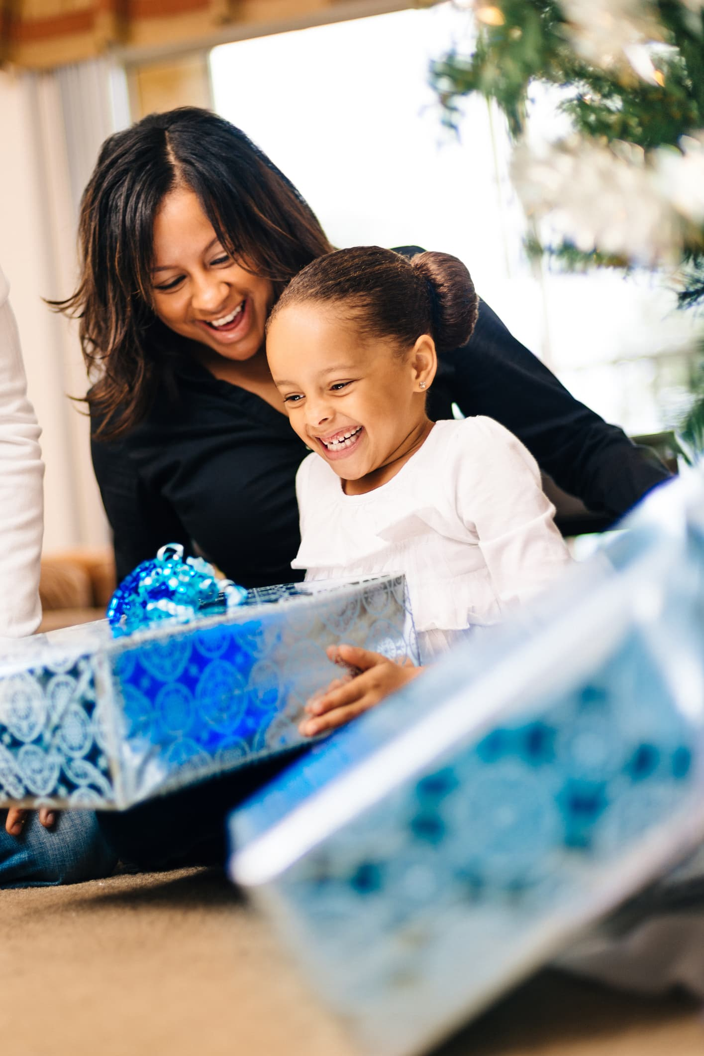 Mother and daughter with holiday gifts