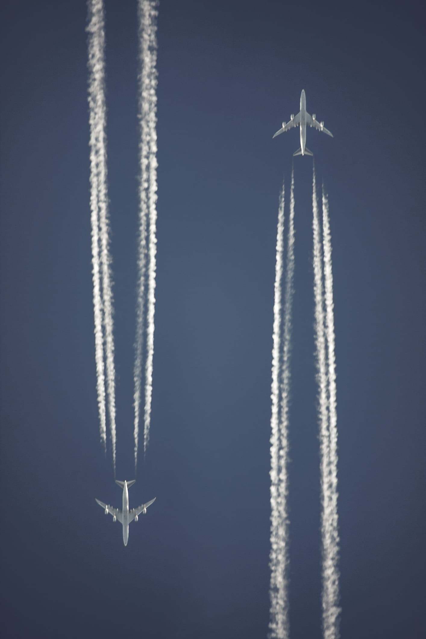 Vapour trails of two airplanes passing by